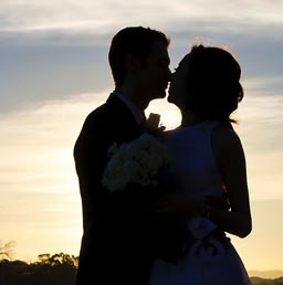 A silhouette of a mature dating couple.