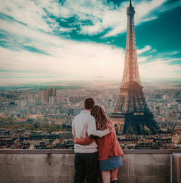 A couple looking at the Eiffel Tower during one of their best dates.
